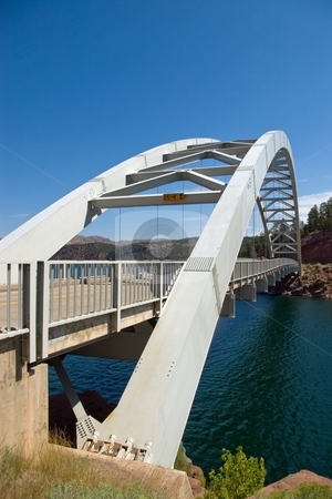 Highway Bridge stock photo, An arched highway bridge spanning a small lake. by Andrew Orlemann