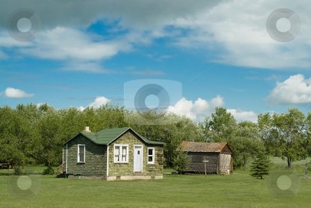 Abandoned Farm House stock photo, An old abandoned farm house shot on a partly cloudy day with copyspace above by Richard Nelson