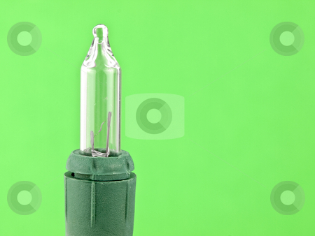 Christmas Light stock photo, Christmas light bulb on a green background by John Teeter