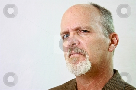 Man with slight smirk on his face. stock photo, Man with slight smirk on his face by Gregory Dean