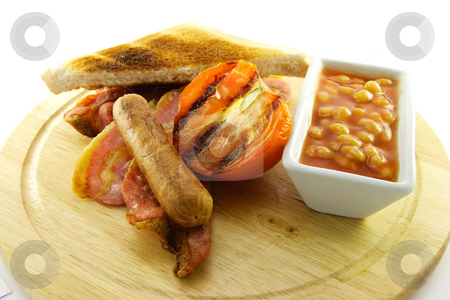 Cooked Breakfast Items on a Wooden Plate stock photo, Delicious cooked breakfast items and baked beans on a wooden plate on a white background by Keith Wilson