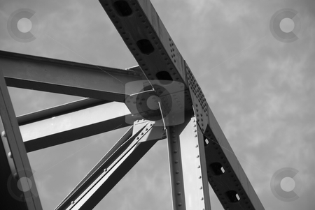 Steel Structure of a bridge stock photo, Steel Structure of a bridge shot from below the bridge and pointing up.  Using the sky as a backdrop for the structure, this image was shot in black and white. by Joseph Jenkins
