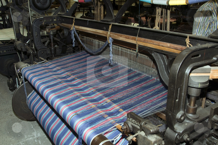 Loom stock photo, The  cotton on the big loom to make textile by Chris Willemsen