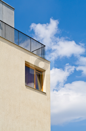 Modern wood house window stock photo, Modern wood house window on yellow wall with blue sky background by Dmitry Mirlin