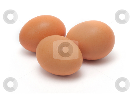Chicken eggs stock photo, Three yellow chicken eggs on white background by Dmitry Mirlin