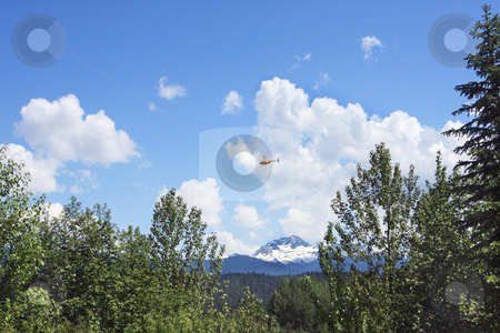 Cloudscape with a helicoter fying by stock photo, Cloudscape with a helicoter fying by by Sharron Schiefelbein