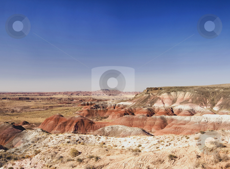 Painted Desert stock photo, A view of the Painted Desert of coloured bands of sand and rock that change from blues to reds thought out the day as the light shifts by Sharron Schiefelbein