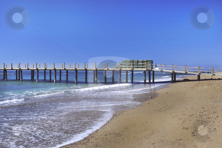 Beach with dock on the Mediterranean Sea stock photo, Beach with dock on the Mediterranean Sea by Sharron Schiefelbein