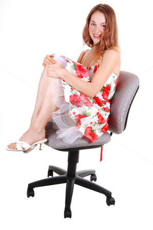 Woman sitting on chair. stock photo, Lovely young woman in high heels sitting on a office chair in the studio with   long brown hair, shooing her nice legs. On white background. by Horst Petzold