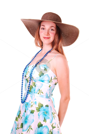 Young lady with hat. stock photo, Beautiful young woman in a blue and green dress and pearl chain with  an big brown straw hat, smiling and looking in the camera, over white. by Horst Petzold