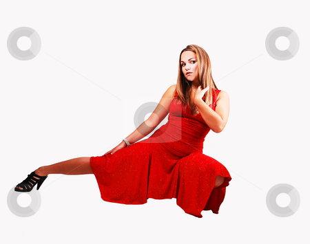 Young girl hocking on floor. stock photo, An pretty, young long haired woman, hocking on the floor, her right leg  stretched out, in a gorgeous red dress for light gray background. by Horst Petzold