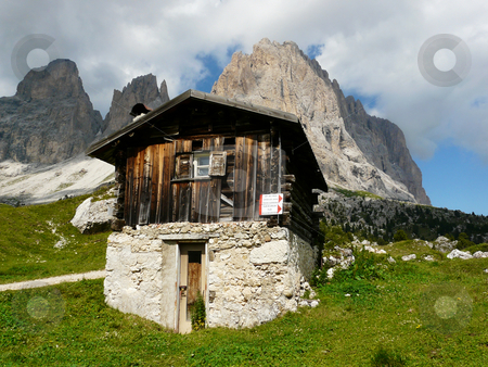 Hut in the Dolomites stock photo, Wooden mountain hut in front of the Langkofel (Italian dolomites) by Peter Van veldhoven