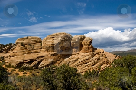 Petrified Dune stock photo, An isolated block of red and white sandstone in the foothills. by Andrew Orlemann