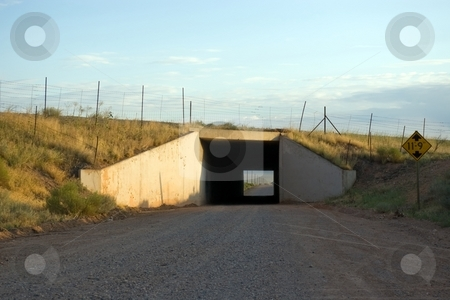 Underpass stock photo, A square cement tunnel under the freeway. by Andrew Orlemann