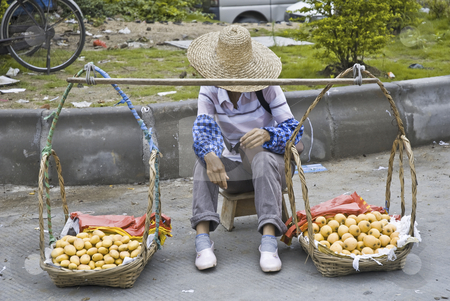 Fruit Sales Woman stock photo, Selling on the street woman in China waiting for customers by Marek Poplawski