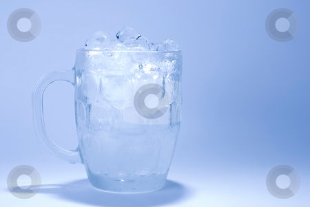 Ice cube in glass stock photo, Ice cube in glass with blue background by Lawren