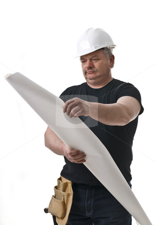 CONTRACTOR stock photo, Busy contractor is reviewing the drawing right on the job by Marek Poplawski