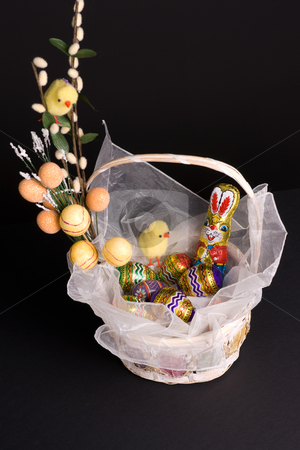 Easter Basket stock photo, Easter holiday spirit basket with bunny chickens and colored eggs by Marek Poplawski