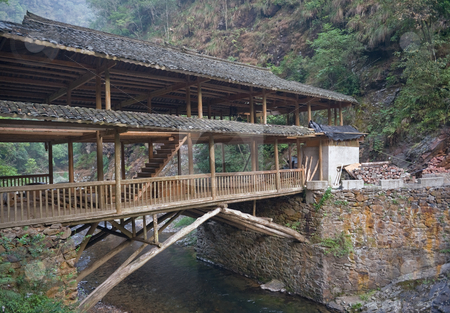 Wodden bridge in China stock photo, Southern China near Guilin wodden bridge over the mountain river by Marek Poplawski