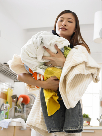 Woman doing house work stock photo, Woman with laundry basket by eskaylim
