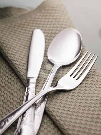 Cutterly set  stock photo, Cutterly set of knife,fork and spoon on the place mat by eskaylim