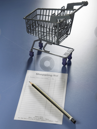 Shooping cart,pencil and shopping list stock photo, Shot of the shooping cart,pencil and shopping list by eskaylim