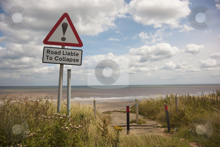 End of the road 2 stock photo, A warning sign near the coast in summer by Mike Smith