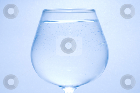 Clear water little bubble and glass stock photo, Clear water with little bubble in the glass. by Lawren