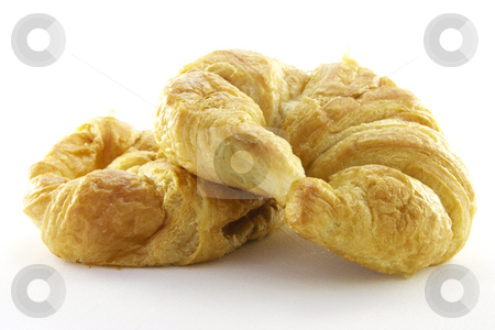 Croissant stock photo, Golden flakey delicious baked croissant on a white background by Keith Wilson