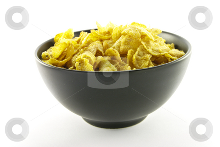 Cornflakes in a Bowl stock photo, Golden cornflakes in a bowl with a white background by Keith Wilson
