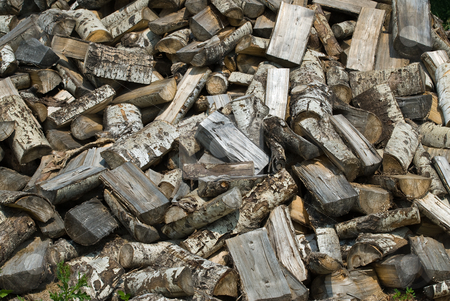 Wood Pile Background stock photo, A background of chopped wood lying in a large pile by Richard Nelson
