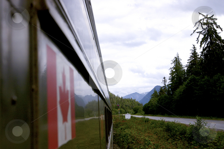 Train with a reflection of Canadian flag stock photo, Train with a reflection of Canadian flag by Sharron Schiefelbein