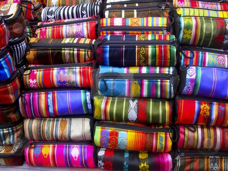 Ecuadorian woven bags stock photo, Mutil colored Ecuadorian woven bags made from alpaca wool found in an Ecuador market, South America by Sharron Schiefelbein