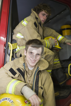 Two young Firemen stock photo, Waiting for the debriefing by Sharron Schiefelbein