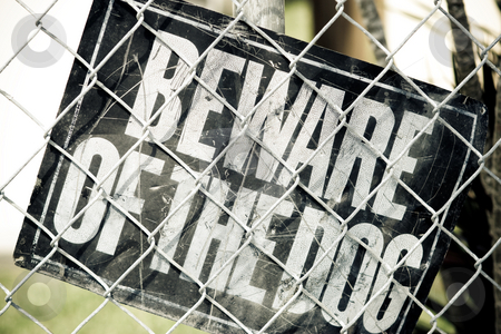 Dog Warning stock photo, Beware of the Dog Sign inside a fenced urban area by Jose Wilson Araujo