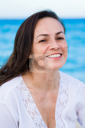 Woman on the beach stock photo, Beautiful adult woman in the 40's on the beach by Jose Wilson Araujo
