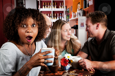 Shocked African American Woman with Friends stock photo, Shocked Pretty African American Woman in Coffee House with Friends by Scott Griessel