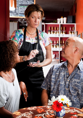 Woman taking order from couple in coffee house stock photo, Woman taking drink order from couple in coffee house by Scott Griessel