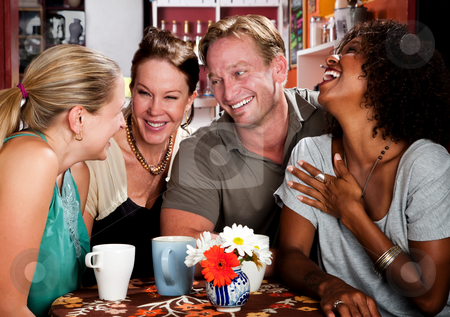 Handsome man with female friends stock photo, Handsome man with female friends in coffee house by Scott Griessel