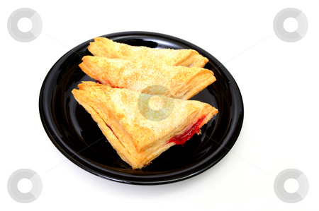 Cherry Turnovers stock photo, Three Cherry turnovers on a black plate isolated on a white background by Lynn Bendickson