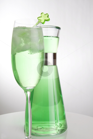 Colorful green drink and can stock photo, Bright green drink in a tall champagne glass and a can in the background by Daniel Kafer