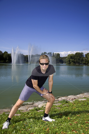 Working out in the park stock photo, Man working out in a beautiful park by a lake by Daniel Kafer