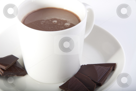 Hot chocolate in style stock photo, Hot chocolate in a white cup with peices of dark deluxe chocolate on the side by Daniel Kafer
