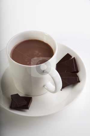 Peices and cup of chocolate stock photo, Hot chocolate in a white cup with peices of dark deluxe chocolate on the side by Daniel Kafer