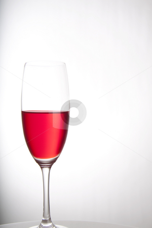 Colorful party drink stock photo, Red cocktail for a party or celebration served in a champagne glass by Daniel Kafer