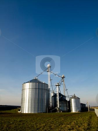 Modern silos stock photo, Modern farmer silos factory in open fields by Laurent Dambies