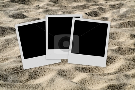 Empty photo frames  on sand background stock photo, Set of three  blank polaroid films on sand background by Laurent Dambies