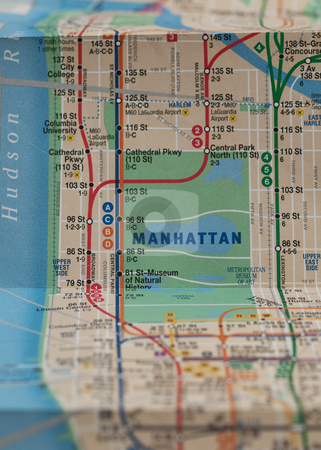 New York subway map stock photo, Folded New York City subway map with selective focus on central park by Laurent Dambies