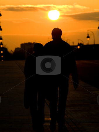 Couple at sunset stock photo, Couple walking over the Pont Neuf bridge in Toulouse at sunset by Laurent Dambies