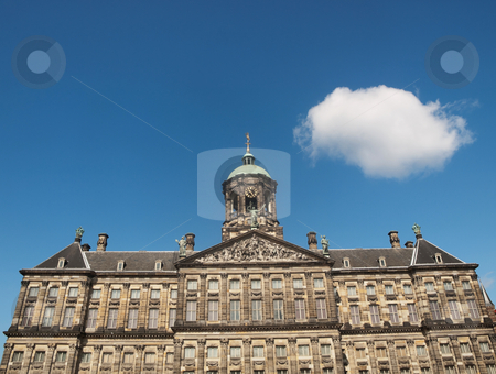 Royal palace of Amsterdam stock photo, Royal palace of Amsterdam at the Dam square under blue sky with single fluffy cloud by Laurent Dambies